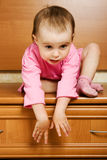 Little baby can not come down from a height Royalty Free Stock Image