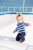 Little baby captain on boat on summer cruise, nautical fashion. Adorable cute little baby captain on boat or sailing yacht on summer cruise. travel adventure Stock Photography