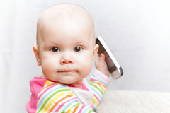 Little baby in casual colorful with mobile phone Stock Photos