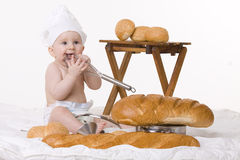 Little baby chef, baguettes and bread Stock Photo
