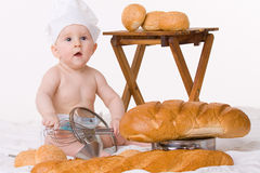 Little baby chef with bread over white Stock Photos