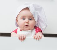 Little baby in a chef's hat Stock Photography
