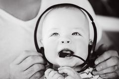 Infant Baby Child Boy Six Months Old with Headphones. Little Baby Child Boy Six Months Old with Headphones royalty free stock photography