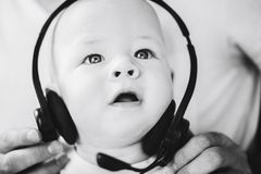 Infant Baby Child Boy Six Months Old with Headphones. Little Baby Child Boy Six Months Old with Headphones royalty free stock photo