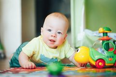 Infant Baby Child Boy Six Months Old is Playing on a Floor. Little Baby Child Boy Six Months Old is Playing on a Floor royalty free stock images
