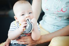 Infant Baby Child Boy Six Months Old is Takes his Shoe in the Mouth. Little Baby Child Boy Six Months Old is Takes his Shoe in the Mouth stock images