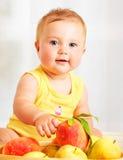 Little baby choosing fruits stock photos