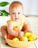 Little Baby Choosing Fruits Stock Images