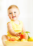Little baby choosing fruits Stock Photography