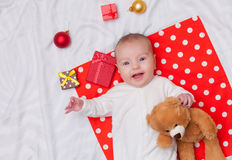 Little baby with christmas gifts Stock Image