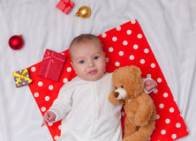 Little baby with christmas gifts Stock Images