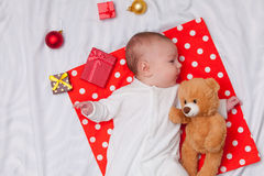 Little baby with christmas gifts Royalty Free Stock Photos
