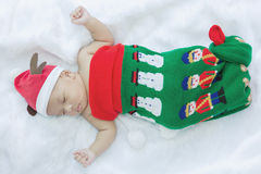 Little baby in Christmas socks and cap. Little baby in Christmas socks Royalty Free Stock Images
