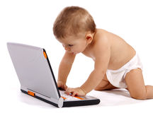 Little baby with computer. Little boy playing with his laptop isolated on white royalty free stock image