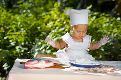 Little baby in cook hat. Stock Photo