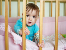 Little baby in a cot. Royalty Free Stock Photo