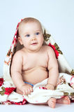 Little baby covered with a bright blanket Stock Photo