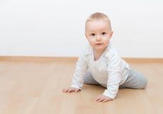 Little baby crawling. Little baby boy crawling look at the camera stock photos