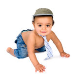 Little baby crawling. Cute African baby boy crawling in his little jeans royalty free stock photography