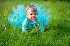 Little baby crawling on grass Royalty Free Stock Images