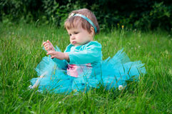 Little baby crawling on grass outdoors Royalty Free Stock Photo