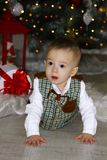 Little baby crawling near Christmas tree.  stock images