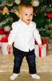 Little baby crawling near Christmas tree.  royalty free stock photography