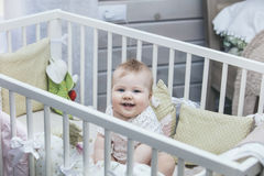 Little baby is in the crib woke up in the morning and smiling royalty free stock photo