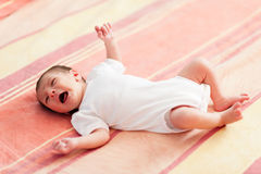 Little baby crying. Cute little baby crying on the bed royalty free stock photography