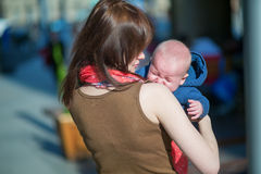 Little baby crying in his mother's arms Stock Images
