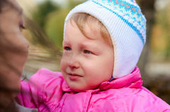 Little baby crying in the park. Fall season Stock Photography