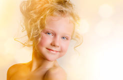 Little baby with curls Royalty Free Stock Photography