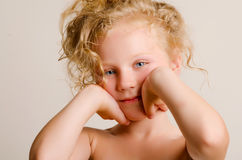 Little baby with curls Stock Image