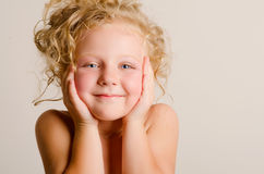 Little baby with curls Stock Photography