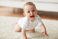 Little baby in diaper crawling on floor at home Stock Photography