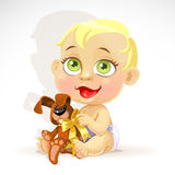 Little baby in a diaper with a plush rabbit Royalty Free Stock Photography