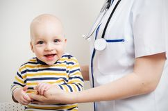 Little baby and doctor Royalty Free Stock Photo