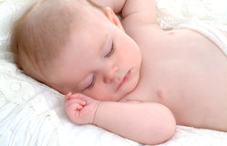 Little Baby Dreamer. Closeup of sleeping baby lying on white blanket in a comfortable position Stock Images