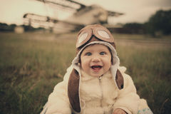 Little baby dreaming of being pilot Stock Images