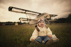 Little baby dreaming of being pilot Stock Image