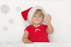 Little baby dressed as Santa under the falling snow Royalty Free Stock Photos