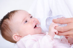Little baby drinking milk from bottle Royalty Free Stock Photography