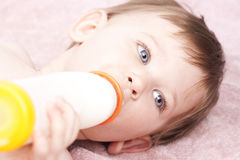 Little baby drinking milk, close up Royalty Free Stock Images
