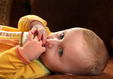Baby Drinks From Bottle. Little Baby Drinks From Bottle Closeup Royalty Free Stock Photo
