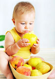 Little baby eating apple Stock Photos