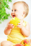 Little baby eating apple Royalty Free Stock Photo