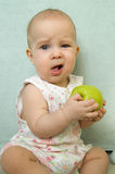 Little baby eating apple stock images