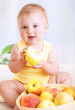 Little baby eating apple Royalty Free Stock Photos