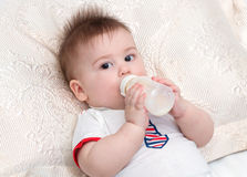 Little baby eating Stock Image