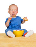 Little baby eating biscuits Stock Image